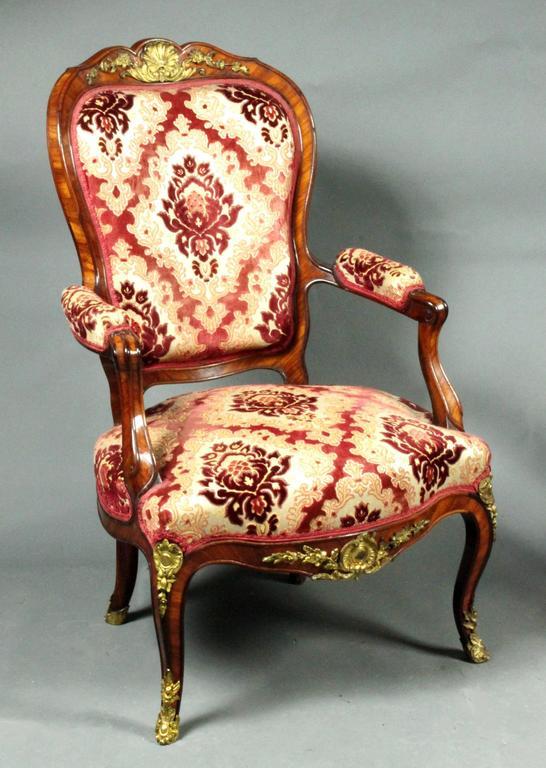 A fine pair of Louis XV style chairs. Herringbone bone crossbanding in kingwood and the original ormolu mounts.