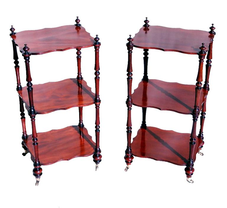 A very attractive mid-19th century mahogany pair of whatnots, or
