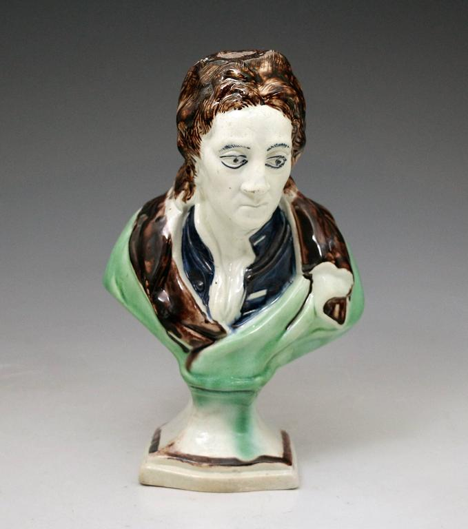 "Antique pottery bust in colored glazes in the Ralph Wood fashion of the English poet ""John Milton""."