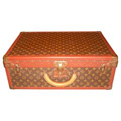 A Vintage Louis Vuitton Monogram Alzer Suitcase