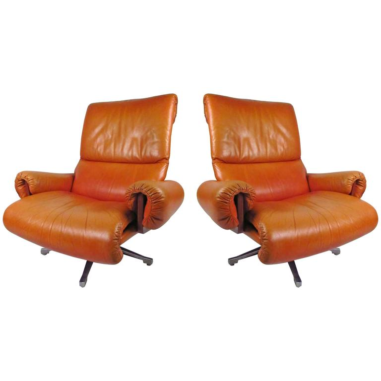 Pair of Midcentury Style Danish Rosewood and Leather Swivel Lounge Chairs For Sale