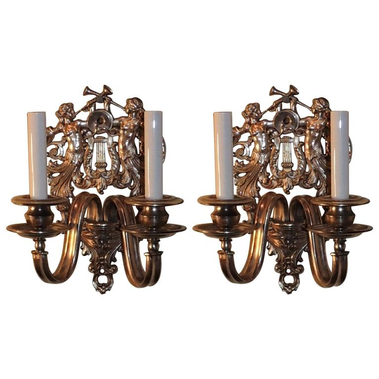 Wonderful Pair of Two-Light Silvered Bronze Figural Trumpets Caldwell Sconces
