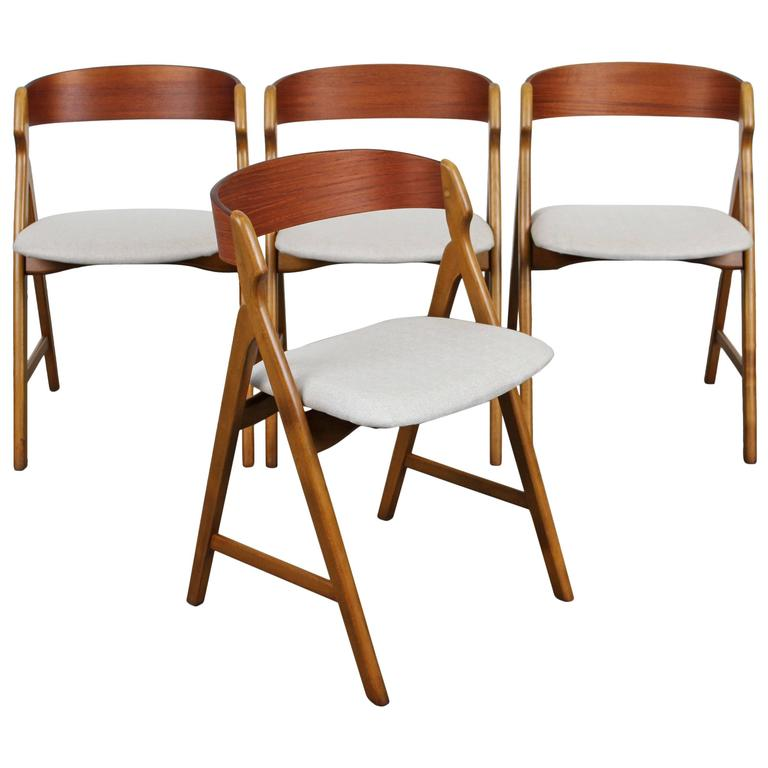 this set of four mid century danish modern teak dining chairs is no