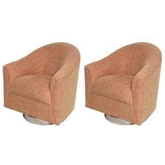 Pair mid century modern swivel barrel back lounge chairs