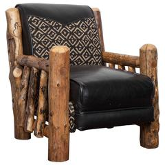 Child's chair handmade in natural log and leather, signed by the artist