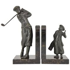 French Art Deco bookends golfer with caddy, 1930