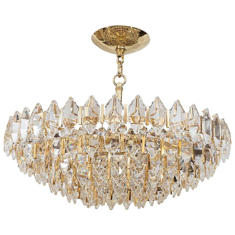 Tiered Brass and Crystal Chandelier For Sale