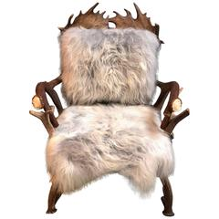 Antler chair with grey Iceland sheepskin upholstery