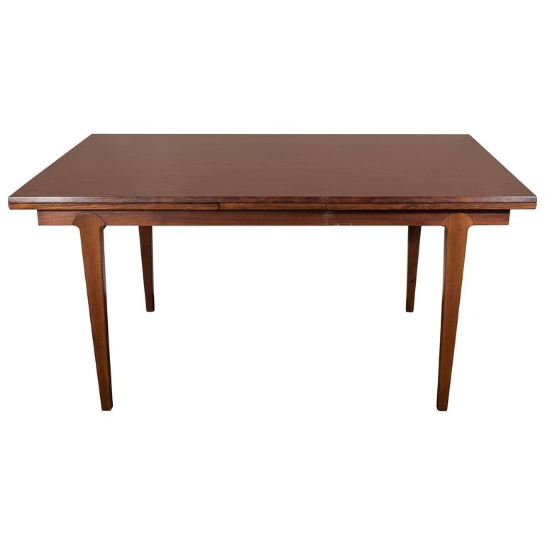 scandinavian midcentury dining table with extension leaves