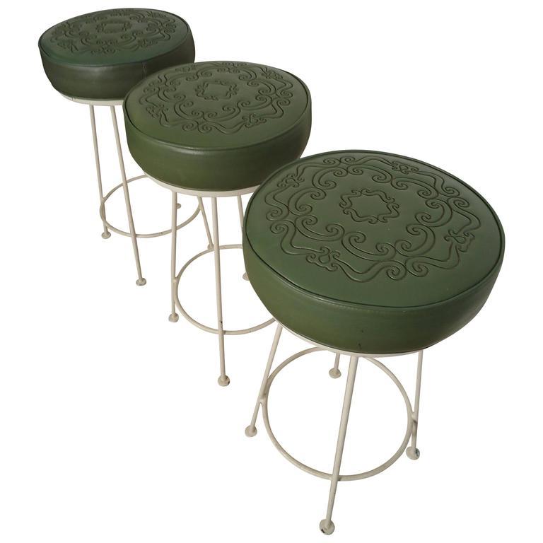 Three Midcentury Iron and Vinyl Barstools