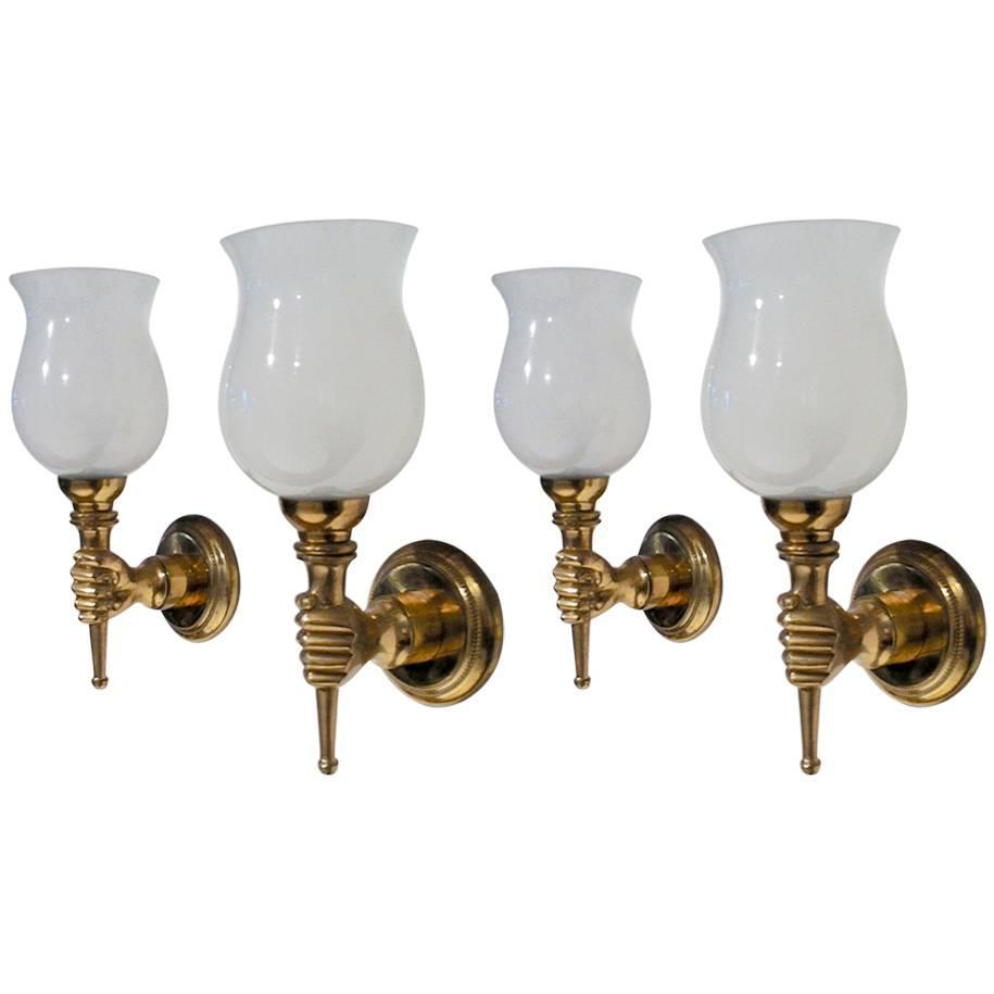 john devoluy set of four gold bronze hand sconces with