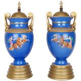 Pair of Neoclassical Painted Blue Porcelain Lamp Bases with Chariots Scenes