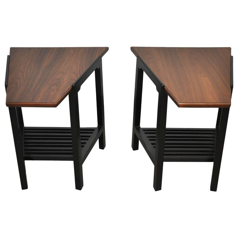 Wedge form end tables by Edward Wormley for Dunbar. Refinished walnut tops over espresso tone bases.