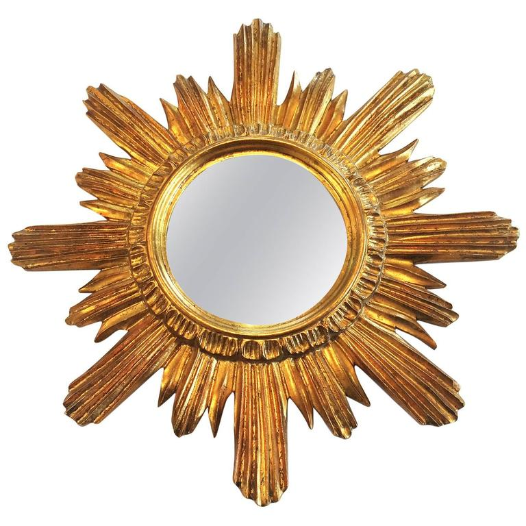 French Art Deco Carved And Gilded Sunburst Mirror For