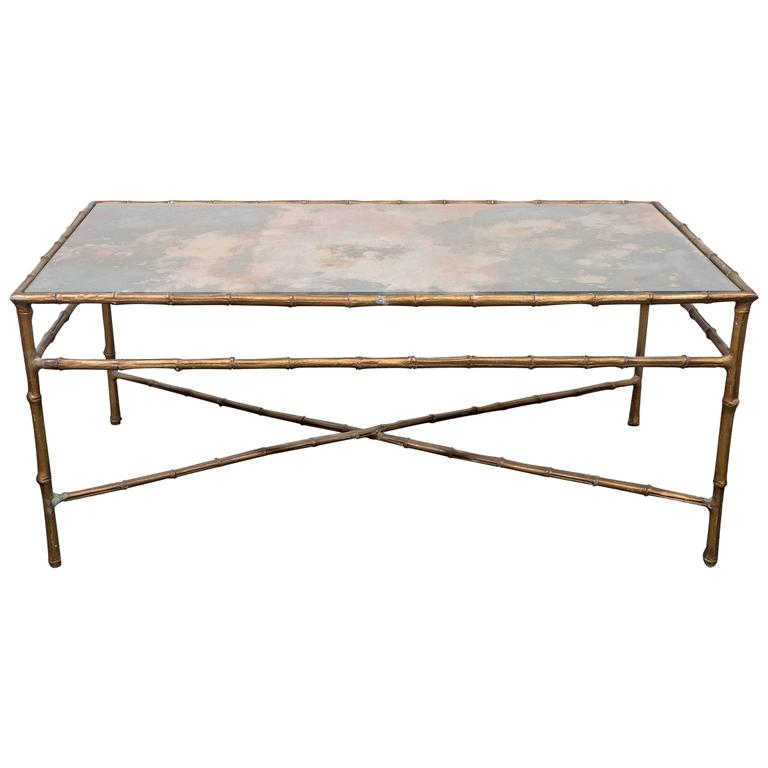 A Maison Baguès Style Faux Bamboo Brass Coffee Table with Smoked Glass Top