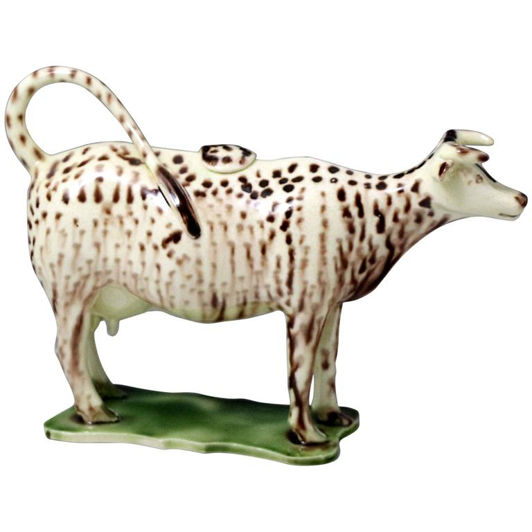 Early English pottery creamware bodied cow creamer figure