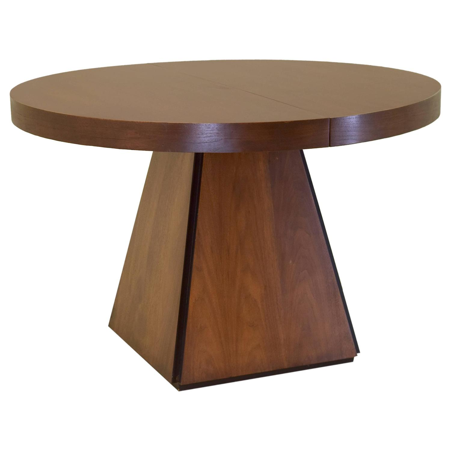 Pierre Cardin Round Obelisk Dining Table In Walnut With Extension Leaf At 1stdibs