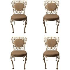 Four Woodard Dining Chairs