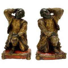 Pair of Italian Wooden Polychrome Parcel-Gilt Figures of Kneeling Blackamoors