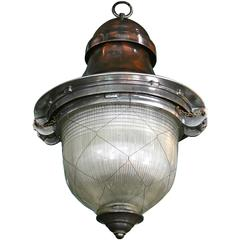 Impressive French Pendant Lanterns with original netted holophane glass