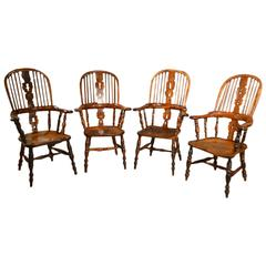 A Wonderful Set of 4 Yew Wood Broad Arm Windsor Chairs
