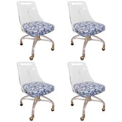 Set of Four Caster Mounted Lucite Dining Chairs by Hill Manufacturing