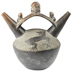 Chimu Blackware Stirrup Vessel, Warrior and Frogs, 12th Century