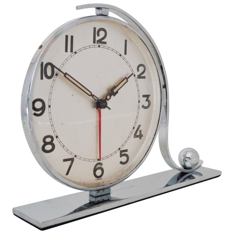 Large german art deco circular alarm clock with tilde and Art deco alarm clocks