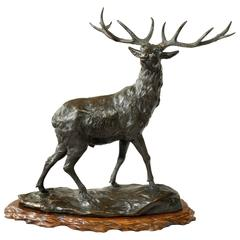 A magnificent bronze stag by Genryusai Seiya.