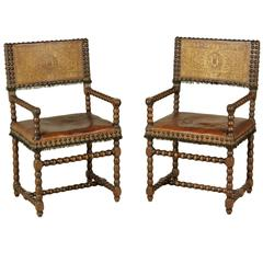 Two 17th Century Renaissance Walnut and Leather Armchairs