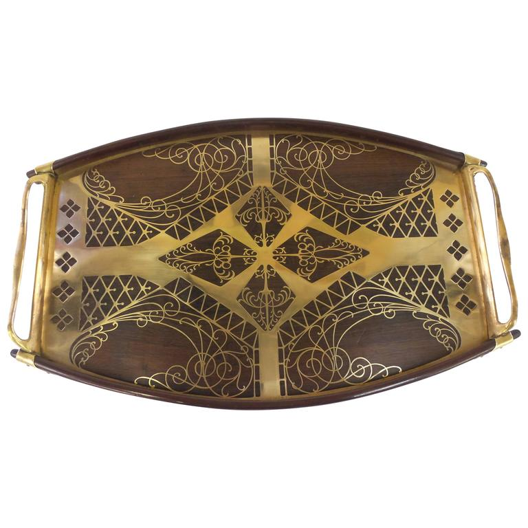 A Secessionist period tray with brass and rosewood geometric inlay on a mahogany and brass body. By Erhard & Sohne, Austria, circa 1905.