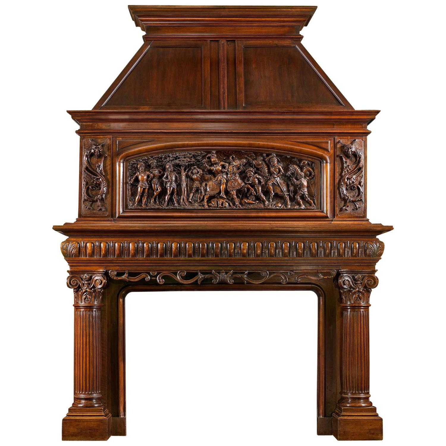 For Sale on 1stdibs - The Italian Wars A substantial and imposing richly carved French walnut trumeau chimneypiece. The generously moulded cornice lies above a dramatically