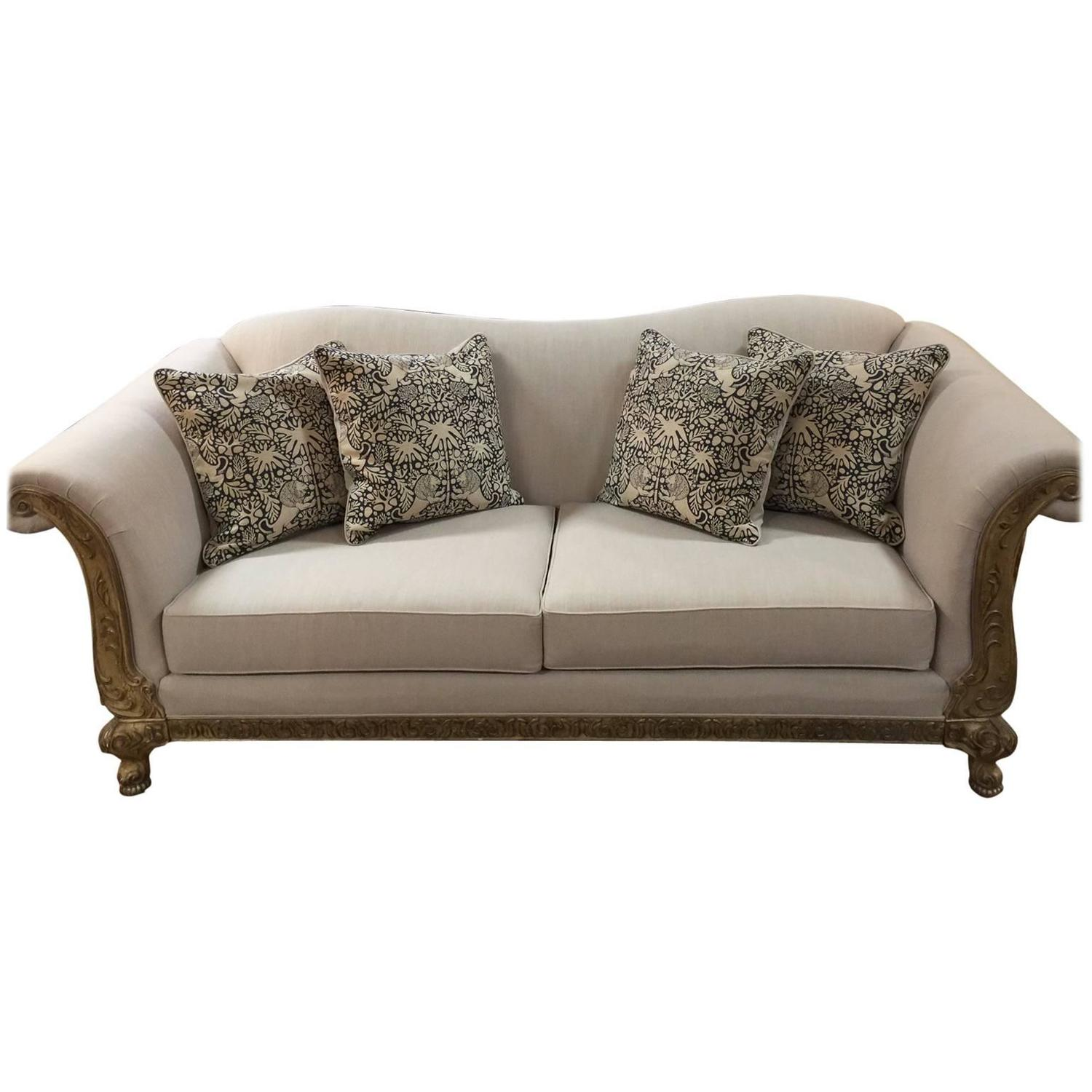 Vintage sofa with wood carved trim and pillows at stdibs