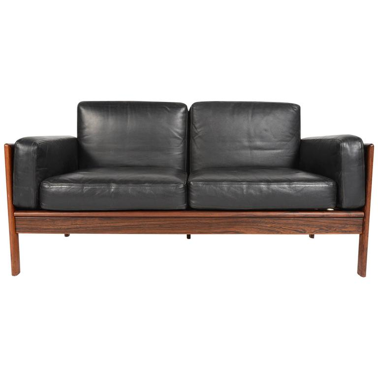 h w klein black leather and rosewood sofa by komfort at 1stdibs. Black Bedroom Furniture Sets. Home Design Ideas