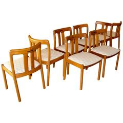 Eight Uldum Teak Dining Chairs with Rosewood Inlay