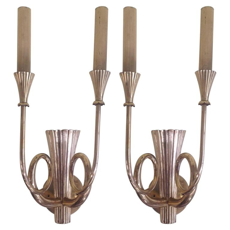 Extraordinary pair of brass wall sconces