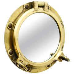 Very decorative Solid Brass Nautical Bullseye with Mirror, ca. 1950`s