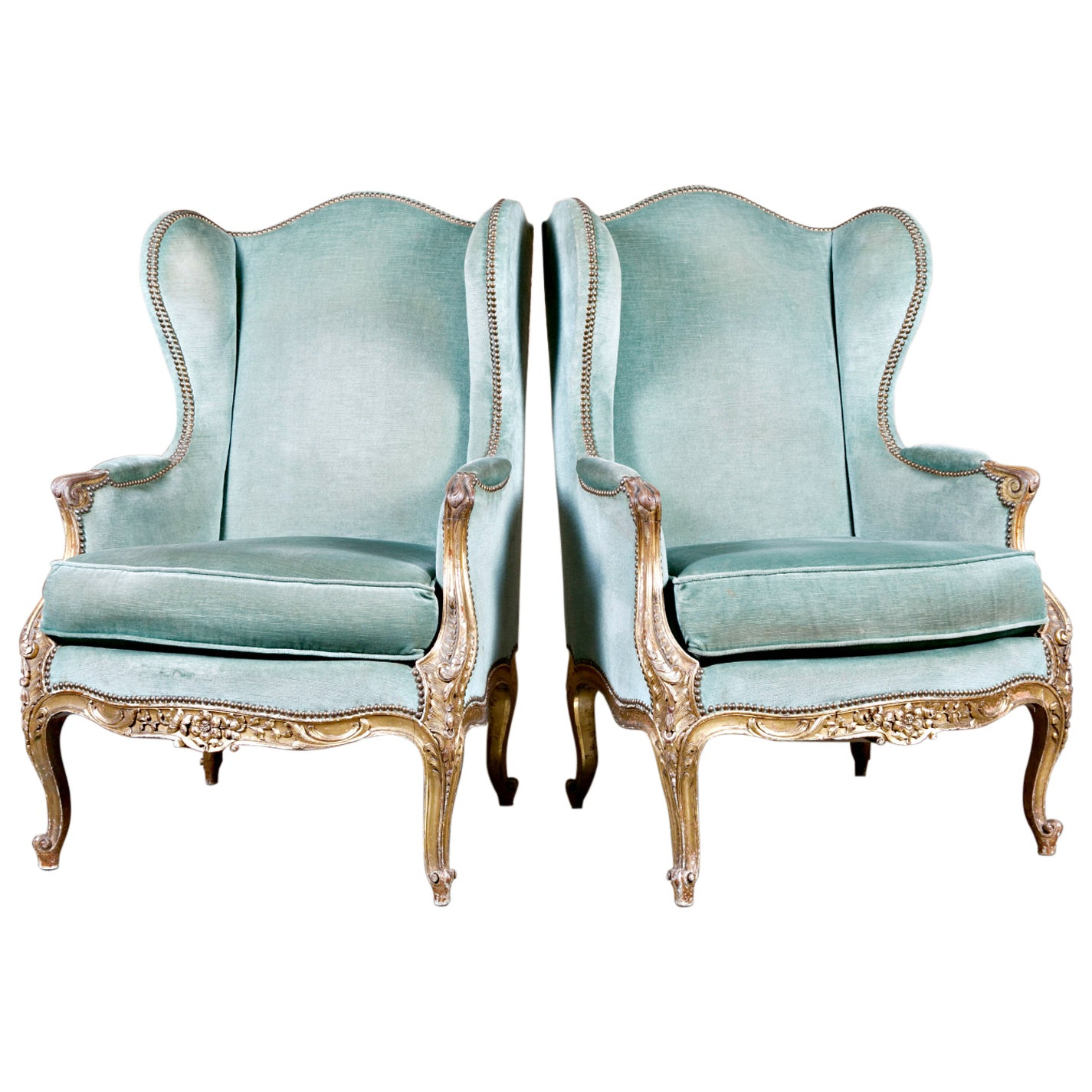 Pair of Exceptional 19th Century French Carved Giltwood Louis XV Style Bergeres