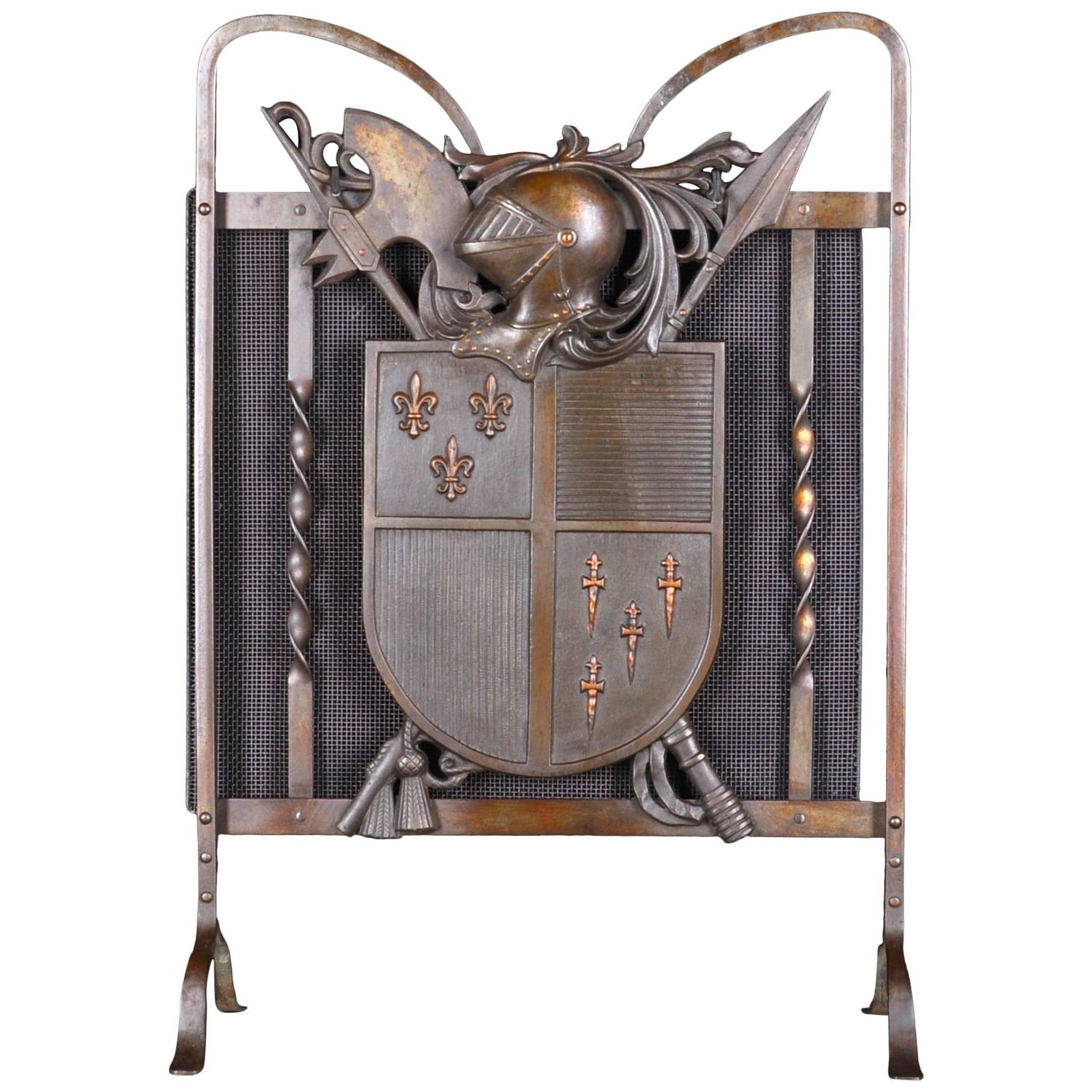 armorial bronze and iron fire guard with medieval trophies and