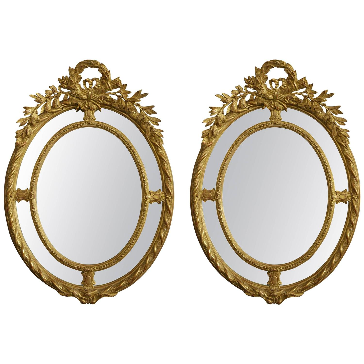 Pair of highly decorative oval gilt mirrors at 1stdibs for Fancy oval mirror