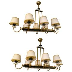 Pair of French Brass, Gunmetal and Lucite Chandeliers Attributed to Jansen