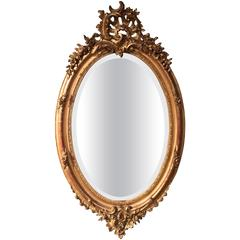 19th Century, Louis XV Carved Gold Leaf Oval Mirror with Beveled Glass