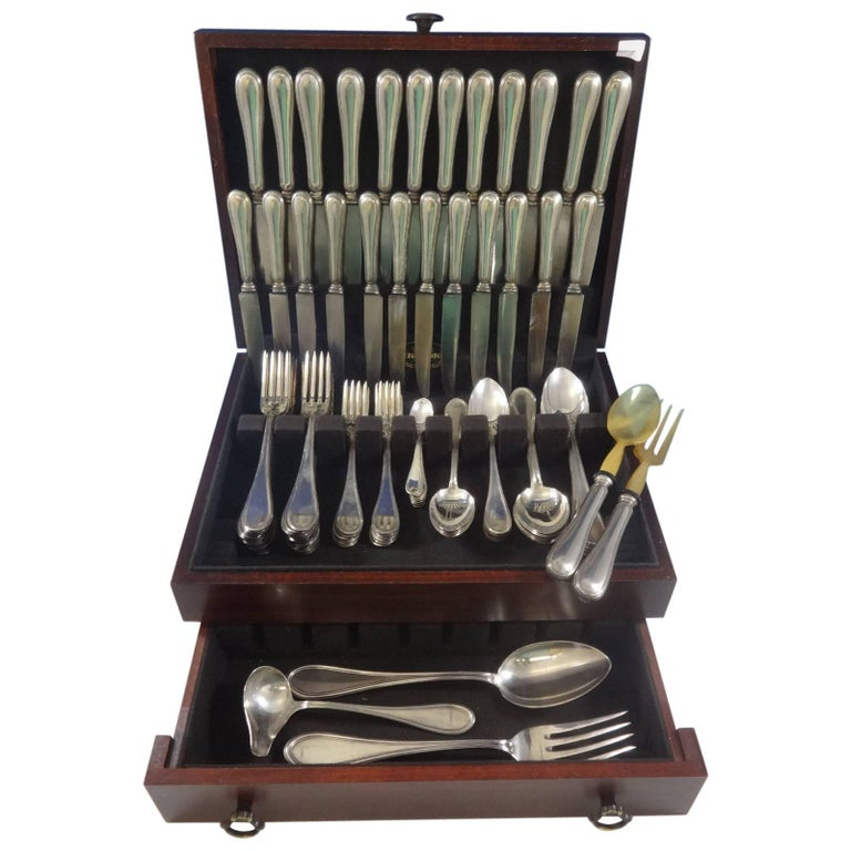 This superb 101 piece dinner size 800 silver old Italian (Italy) set is highest Italian quality, large and heavy and includes:  12 dinner size knives, 10