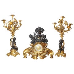Three-Piece Gilt and Patinated Bronze Clock Garniture Set