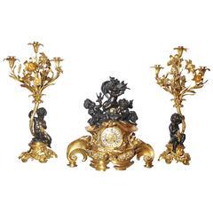Three-Piece Gilt and Patinated Bronze Clock Garniture Set