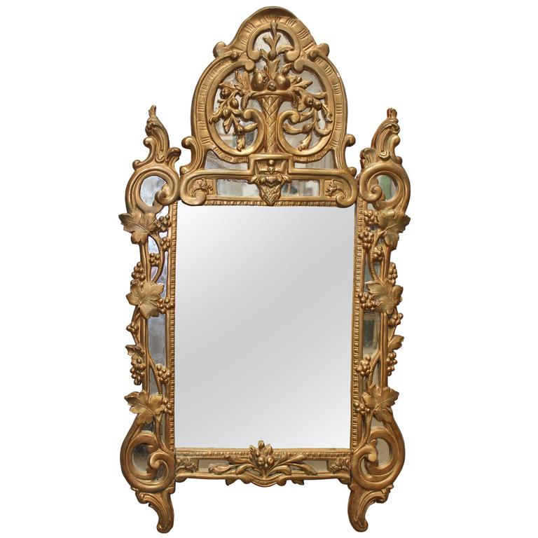 A French Regence Style Small Scaled Gilt Wood Mirror For Sale