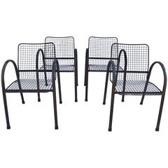 Four Patio Wrought Iron Mesh Arm Chairs