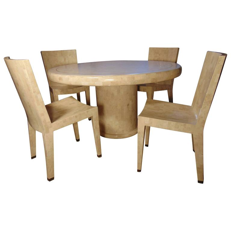 Tessellated marble dining table and four chairs by