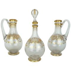 Three Piece Crystal Decanter Set with Gold Decorations Attributed to Baccarat