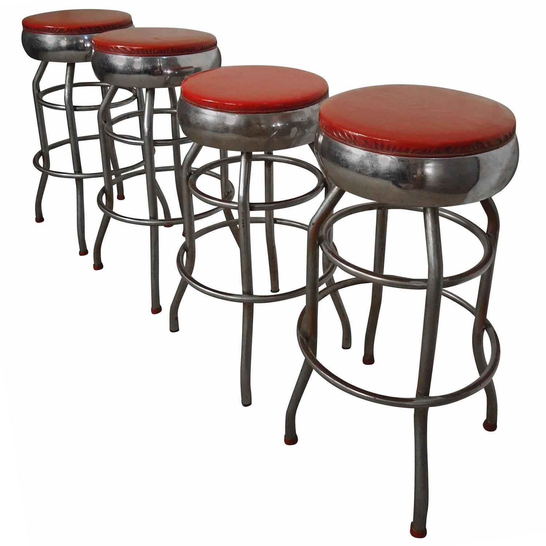 Four midcentury chrome and vinyl bar stools at stdibs